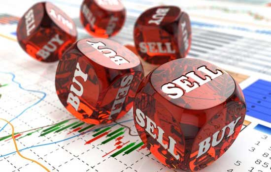 An image of dices showing buy and sell text on it
