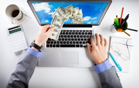 A computer showing money in IT industry